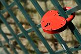 red padlock  on fence