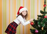 girl with ball for christmas tree