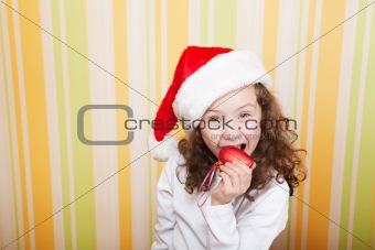 little girl bites a heart