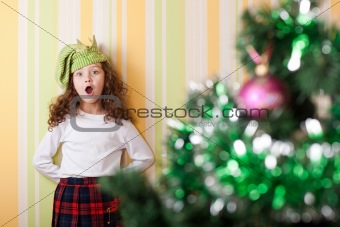 girl posing near christmas tree