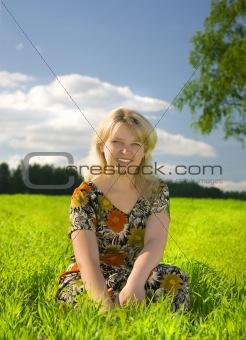 Beautiful young blonde woman in a field