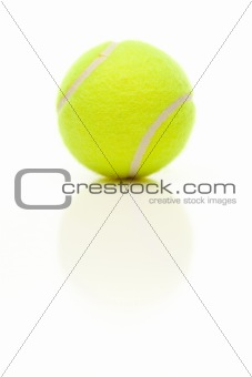 Single Tennis Ball with Slight Reflection Isolated on a White Background.