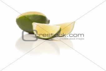 Sliced Lime on a Reflective White Surface.