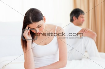 Upset couple sitting sitting separately after having a row