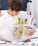 Close-up of a little boy playing with a teddy bear