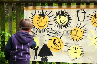 baby paints the sun outdoor