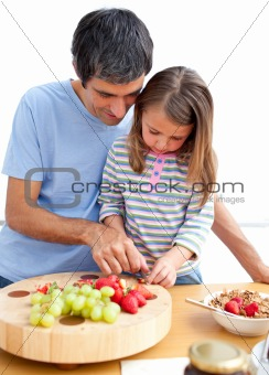 Father and his daughter having breakfast in the kitchen