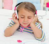 Close-up of a Little gril listening to music with headphones 