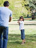 Jolly little boy playing baseball with his father