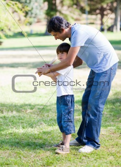 Loving little boy playing baseball with his father