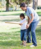 Charming father playing baseball with his son