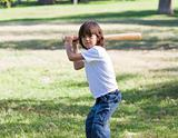 Portrait of adorable child playing baseball