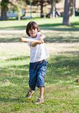 Lively little boy playing baseball