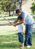 Beautiful father playing baseball with his son