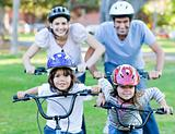 Happy family riding a bike