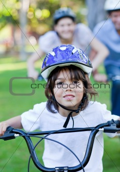 Adorable little boy riding a bike