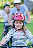 Cute little girl riding a bike
