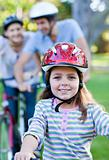 Smiling little girl riding a bike