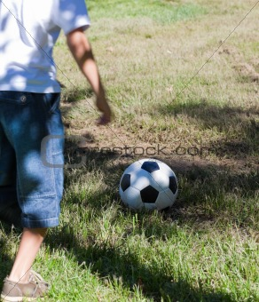 Little boy playing soccer