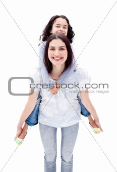 Attractive mother giving her daughter a piggyback ride