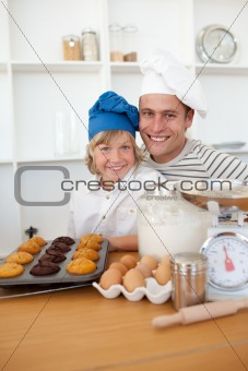 Father and son presenting their muffins
