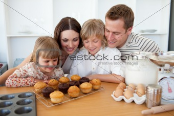 Jolly family presenting their muffins