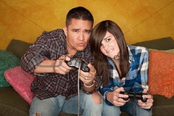 Hispanic Man and Girl Playing Video game