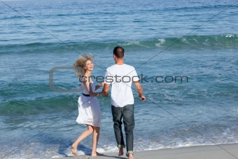 Beautiful couple walking together at the seaside