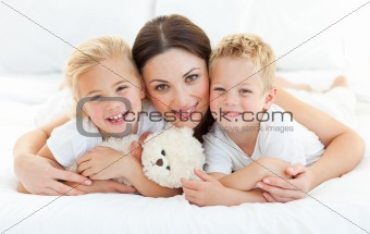 Animated siblings with their mother lying on a bed