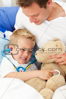 Positive father and his sick son playing with a stethoscope