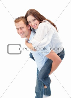 Charming man giving his girl friend piggyback ride