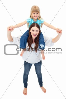 Beautiful mother giving her daughter piggyback ride