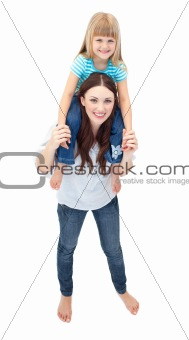 Caucasian brunette mother giving her daughter piggyback ride