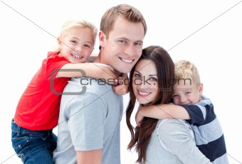 Portrait of joyful family enjoying piggyback ride against a whit