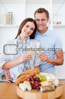Loving couple preparing dinner in the kitchen