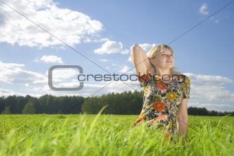 beautiful young woman on field of green grass