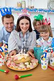 Cheerful family celebrating mother's birthday