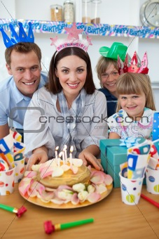 Cheerful family celebrating mother&#39;s birthday