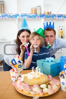 Attentive parents celebrating their son's birthday in the kitchen