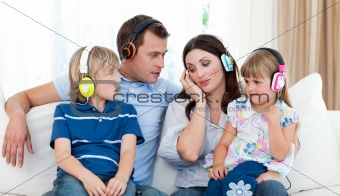 Family listening music with headphones