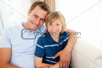 Portrait of an attractive father hugging his son