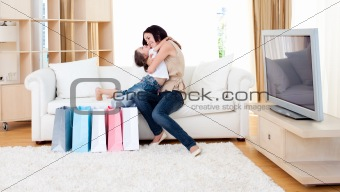 Affectionate mother and her daughter at home after shopping