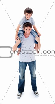 Attractive father giving his son piggyback ride