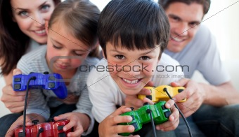 Parents playing video games with their children