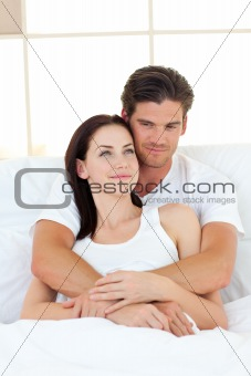 Portrait of happy lovers hugging in their bed