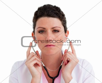 Charismatic female doctor holding a stethoscope