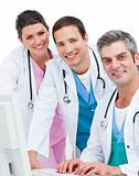 Positive medical team working at a computer