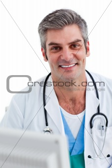 Portrait of a male doctor holding a stethoscope