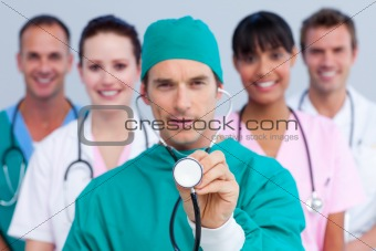 Charismatic surgeon and his medical team