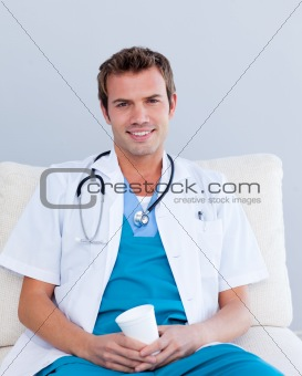Friendly young doctor in hospital looking at the camera